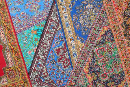 cleanly: Seven varicoloured carpets lie in random order on each other