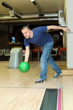exactness: Fellow planted oneself for throw of ball in bowling club