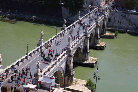 influx: ROME - AUGUST 3: Tourists on Sant Angelo Bridge on August 3, 2010 in Rome, Italy. In 1450 railing of the bridge did not survive influx of pilgrims and fell into the river, many pilgrims were killed. Editorial