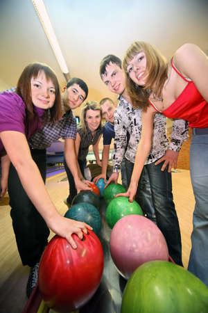 sports hall: Six friends are taken by balls from an automat for playing in bowling
