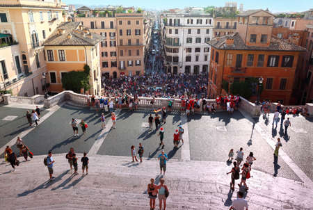 ROME - AUGUST 4: People on the Piazza di Spagna on August 4, 2010 in Vatican City, Rome, Italy. In Rome tax on tourists came into effect. Hotels in Italy will hold a strike against this tax.