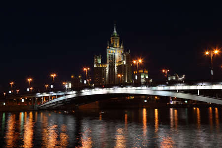 Residential building on Kotelnicheskaya Quay and bridge in Moscow, Russia Stock Photo - 17679797