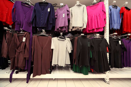 sweatshirts: Inside  large women clothing store, multi-colored jerseys sweatshirts