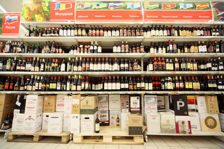MOSCOW - FEBRUARY 6: Shelves with wine inside supermarket, on February 6, 2011 in Moscow, Russia. In Moscow trade of alcohol is prohibited from 22:00 to 8:00. Stock Photo - 17678743
