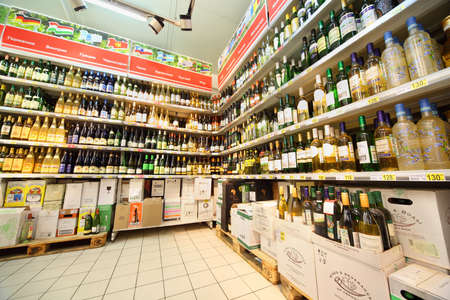 MOSCOW - FEBRUARY 6: Shelves with wine in shop, on February 6, 2011 in Moscow, Russia. In Moscow trade of alcohol is prohibited from 22:00 to 8:00. Stock Photo - 17678751