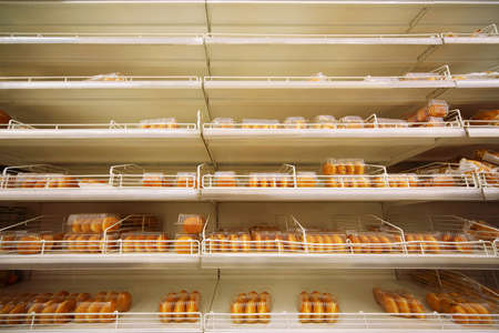 tastiest fresh crispy baking in plastic container on shelf in store Stock Photo - 17678201