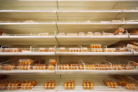 tastiest fresh crispy baking in plastic container on shelf in store Stock Photo - 17678201