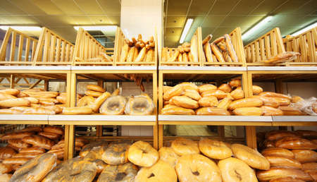 lots of fresh crisp loaves of bread on shelves in store; bread is one of main food Stock Photo - 17679800