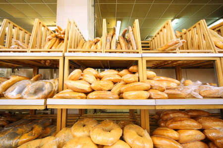 lots of fresh crisp loaves of bread on shelves in store; abundance of delicious soft bread Stock Photo - 17718171