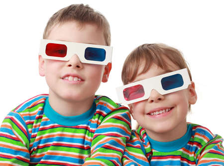 little brother and sister in striped shirt and anaglyph glasses smiling, focus on boy photo