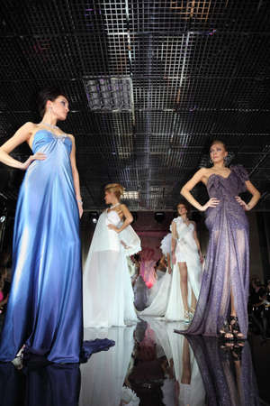 bridal salon: MOSCOW - FEBRUARY 14: Models wear evening dress walks catwalk at evening of French fashion in jewelry salon Estet, on February 14, 2011 in Moscow, Russia. Jewelry House Estet was founded in 1991.