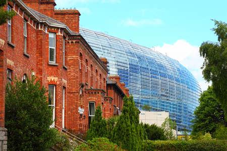 Stadium Aviva and red brick building at day in Dublin, Ireland