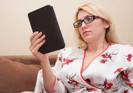 upper half: reading a book. girl with glasses