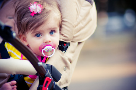 teat: child is sitting in a carriage Stock Photo