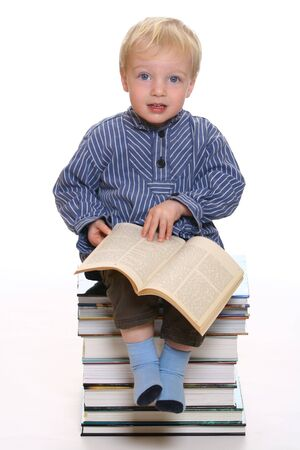 Studying little boy with white background Stock Photo - 6744923