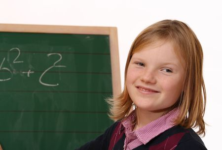 Happy schoolgirl at the chalkboard Stock Photo - 6744934