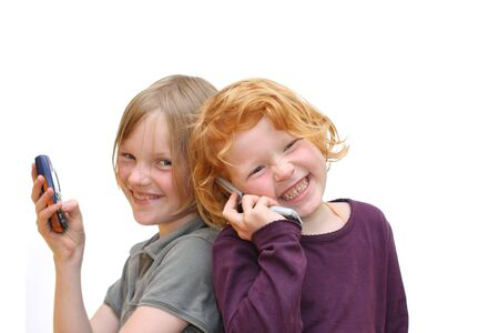 Two gilrls with mobile phones Stock Photo - 6744931