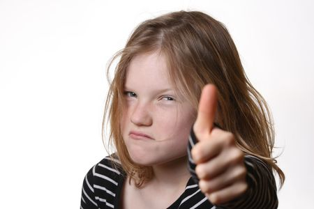 Angry young girl with thumbs up Stock Photo - 6789114