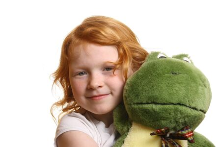 Red-haired girl with toy frog Stock Photo - 6789063