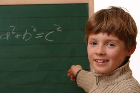 Happy schoolboy at the chalkboard Stock Photo