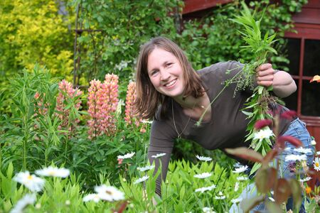 Happy woman works in the garden Stock Photo
