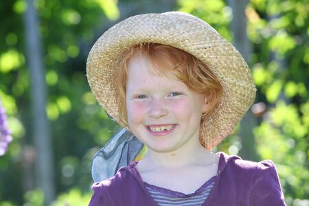 Happy young girl with straw hat Stock Photo - 7423265