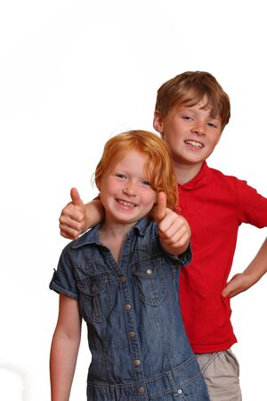 Boy and girl with thumbs-up photo