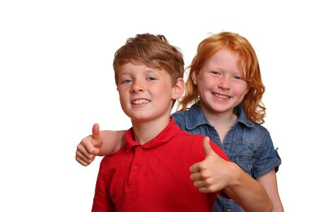 Boy and girl with thumbs-up