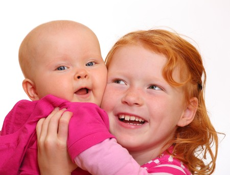 Red-haired girl with her baby sibling Stock Photo - 7716763