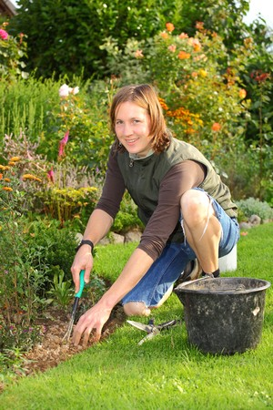 Young woman works in the garden Stock Photo