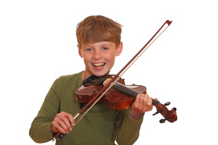 violins: Happy young boy plays his violin Stock Photo