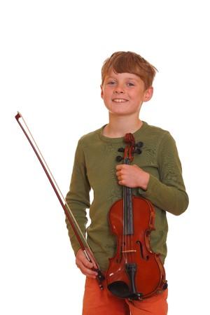 Happy young boy shows his violin