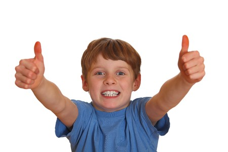 Smiling boy shows thumbs up Stock Photo