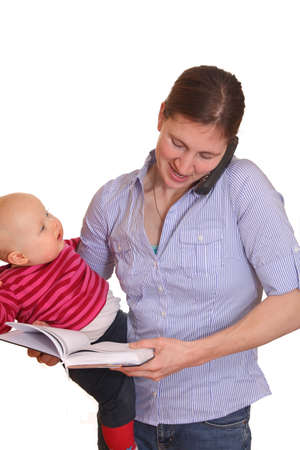 Businesswoman with baby and phone and memo book photo