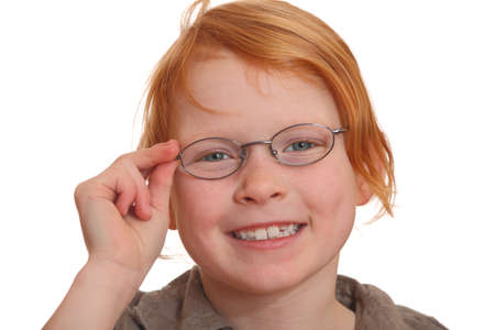 Close-up of clever red-haired girl wearing glasses