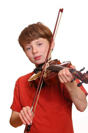 Happy young boy playing violin isolated on white background