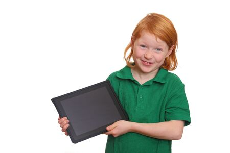 Funny red haired girl presents her new tablet computer Stock Photo - 8575941