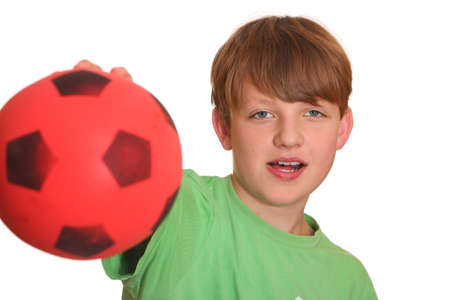 Confident teenage boy shows his soccerball Stock Photo - 8575984