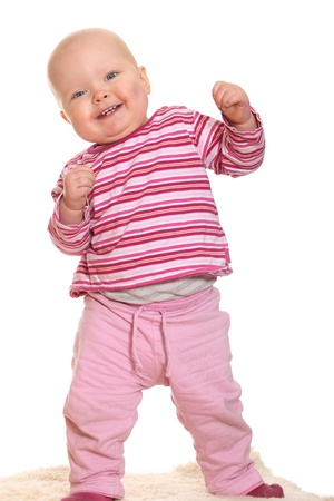 Baby girls first steps Stock Photo