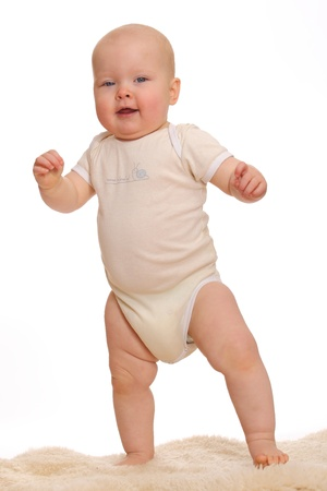 Portrait of a baby doing the first steps