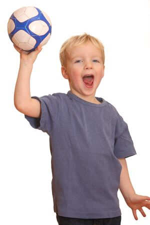 Portrait of a young boy throwing a ball