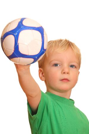 Portrait of a young boy throwing a ball photo