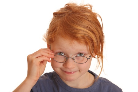 Portrait of a happy red haired girl wearing glasses