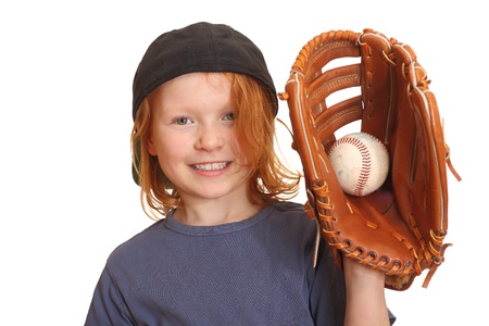 Portrait of a happy red haired giirl with baseball cap glove and ball photo