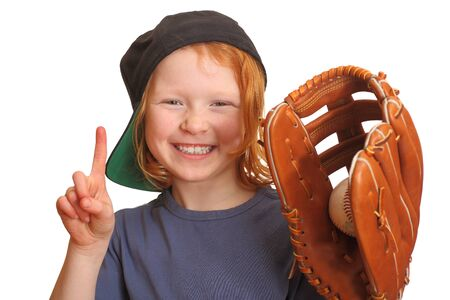 Portrait of a funny red haired giirl with baseball cap glove and ball Stock Photo
