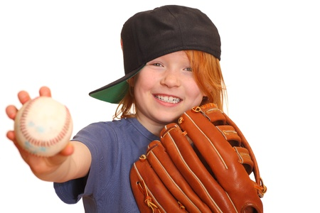 Portrait of a smiling red haired giirl with baseball cap glove and ball