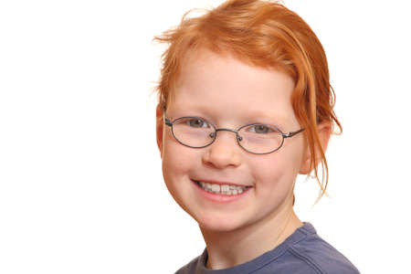 Portrait of a smiling red haired girl with glasses photo