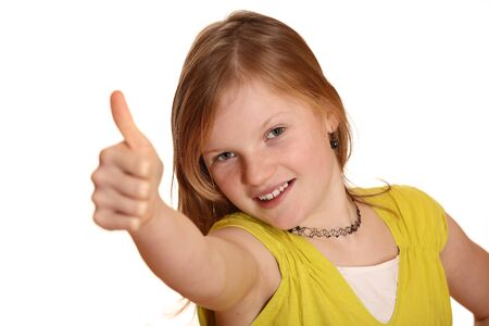 Portrait of a happy young girl with thumb's up sign against isolated white background  Stock Photo - 8831405