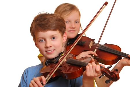 Two kids playing violin isolated on white background photo