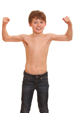 Portrait of a strong young boy showing the muscles of his arms